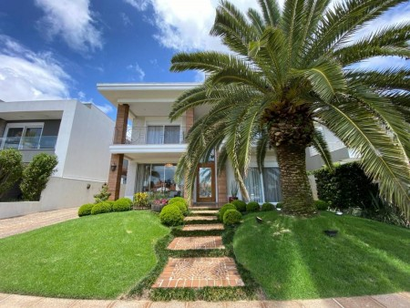 Casa em Condomínio 4 dormitórios em Capão da Canoa   Ref.: 1239
